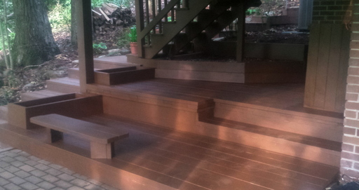 Attractive tiered wooden deck with seating