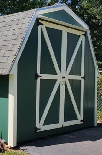A freshly painted shed with new door and trim